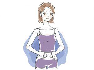 下腹部を手で押さえる女性