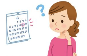 カレンダーを見て悩む女性
